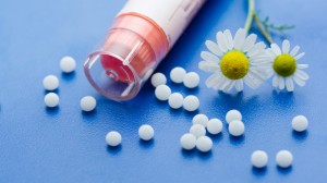 Pills and flowers representing homeopathic medication